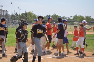 The JCC East Bay baseball team walks off the diamond after playing  Orange County at the 2013 Maccabi Games in Irvine.